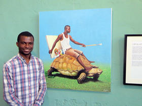 Amani in front of the painting which gave the exhibition its name: Tambola malembe